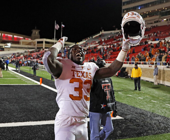 Texas' Gary Johnson (33) celebrates after an NCAA college football game against Texas Tech, Saturday, Nov. 10, 2018, in Lubbock, Texas. (AP Photo/Brad Tollefson)