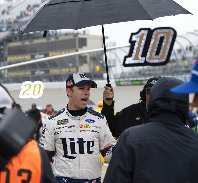 Brad Keselowski speaks after a NASCAR Cup Series auto race was postponed due to inclement weather conditions Sunday, May 5, 2019, at Dover International Speedway in Dover, Del. (AP Photo/Jason Minto)