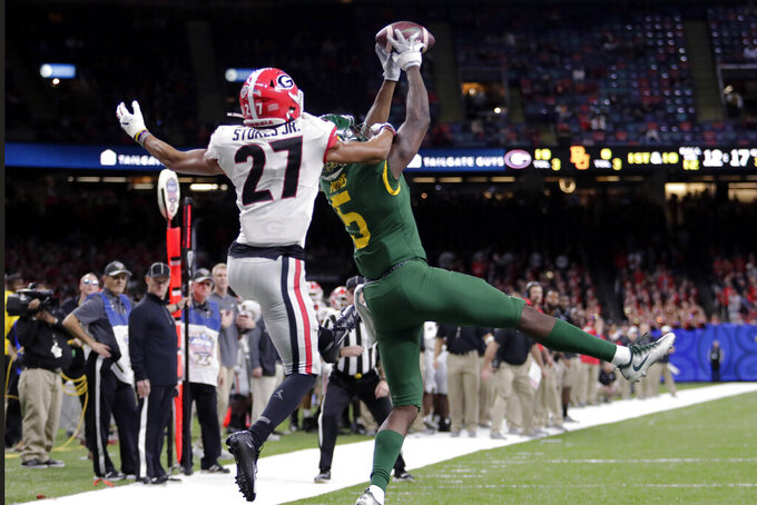 Baylor wide receiver Denzel Mims (5) pulls in a pass reception against Georgia defensive back Eric Stokes (27) in the second half of the Sugar Bowl NCAA college football game in New Orleans, Wednesday, Jan. 1, 2020. (AP Photo/Brett Duke)