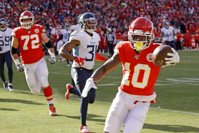 Kansas City Chiefs' Tyreek Hill (10) runs for a touchdown during the first half of the NFL AFC Championship football game against the Tennessee Titans Sunday, Jan. 19, 2020, in Kansas City, MO. (AP Photo/Charlie Riedel)
