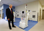 FILE - In this Tuesday, June 25, 2013 file photo, Jeffrey Beard, secretary of the California Department of Corrections and Rehabilitation, looks over a dialysis machine while touring the new California Correctional Health Care Facility during dedication day festivities. Officials say Legionnaires' disease bacteria that killed one inmate and sickened another is more widespread than expected in a California prison. They said Wednesday, April 17, 2019, that preliminary tests found the bacteria in the water supply at a prison medical facility in Stockton and at two neighboring youth correctional facilities. (AP Photo/Rich Pedroncelli, File)