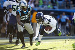 Seattle Seahawks running back C.J. Prosise (22) runs the ball while Carolina Panthers linebacker Bruce Irvin (55) chases during the first half of an NFL football game in Charlotte, N.C., Sunday, Dec. 15, 2019. (AP Photo/Brian Blanco)