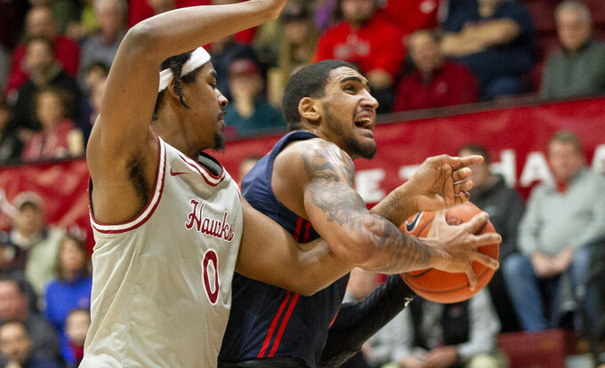 Dayton forward Obi Toppin (1) is fouled by Saint Joseph's forward Chereef Knox (0) during the first half of an NCAA college basketball game, Sunday, Jan. 5, 2020, in Philadelphia. (AP Photo/Laurence Kesterson)
