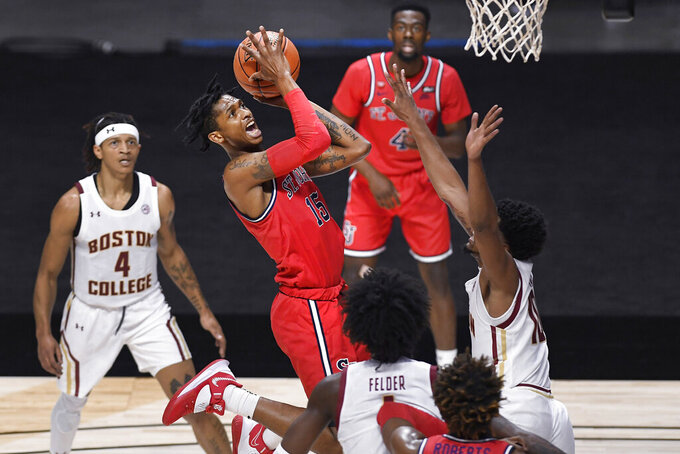St. John's Vince Cole (15) shoots in the first half of an NCAA college basketball game against Boston College, Monday, Nov. 30, 2020, in Uncasville, Conn. (AP Photo/Jessica Hill)