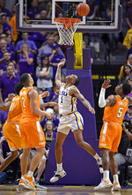 LSU guard Ja'vonte Smart (1) watches the ball float toward the basket along with Tennessee's Kyle Alexander (11), Grant Williams (2) and Admiral Schofield (5) during overtime of an NCAA college basketball game, Saturday, Feb. 23, 2019, in Baton Rouge, La. LSU won in overtime 82-80.(AP Photo/Bill Feig)