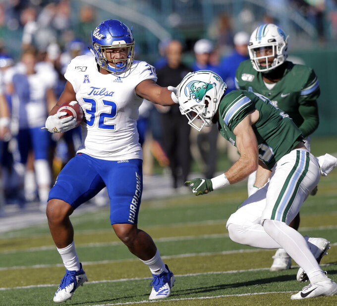 Tulsa tight end James Palmer (32) puts a straight-arm on Tulane safety Chase Kuerschen (36) during an NCAA college football game in New Orleans, La., Saturday, Nov. 2, 2019. (A.J. Sisco/The Advocate via AP)