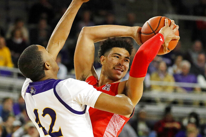 Houston's Quentin Grimes (24) is challenged by East Carolina's Miles James (42) during the first half of an NCAA college basketball game in Greenville, N.C., Wednesday, Jan. 29, 2020. (AP Photo/Karl B DeBlaker)
