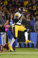 Pittsburgh Steelers cornerback Joe Haden celebrates after breaking up a pass during the second half of an NFL football game against the Los Angeles Chargers, Sunday, Oct. 13, 2019, in Carson, Calif. (AP Photo/Kelvin Kuo)