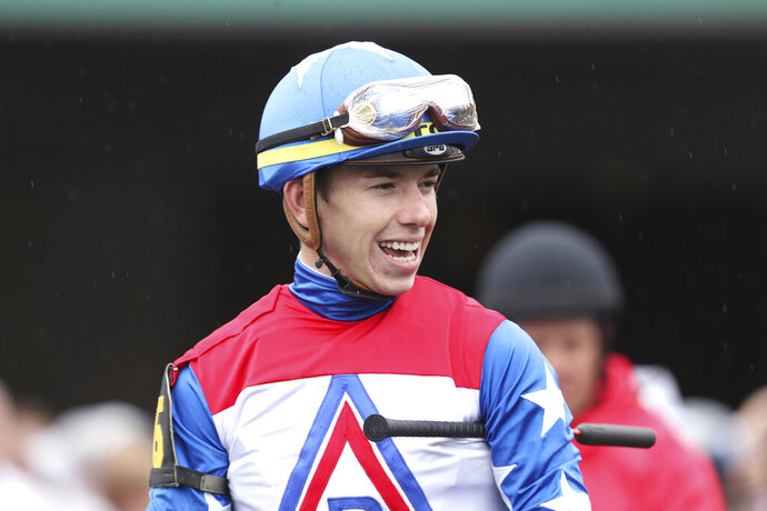 FILE - In this May 4, 2019, file photo, jockey Tyler Gaffalione is shown at Churchill Downs in Louisville, Ky. Gaffalione at 24 has become horse racing's rising star jockey after winning the Preakness and can add to his already impressive resume in the Belmont.(AP Photo/Gregory Payan, File)