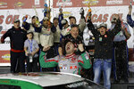 Michael Self, center, celebrates with crew members in Victory Lane after winning the ARCA auto race at Daytona International Speedway, Saturday, Feb. 8, 2020, in Daytona Beach, Fla. (AP Photo/Terry Renna)