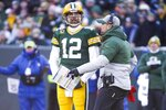 Green Bay Packers head coach Matt LaFleur talks to Aaron Rodgers during the first half of an NFL football game against the Chicago Bears Sunday, Dec. 15, 2019, in Green Bay, Wis. (AP Photo/Mike Roemer)