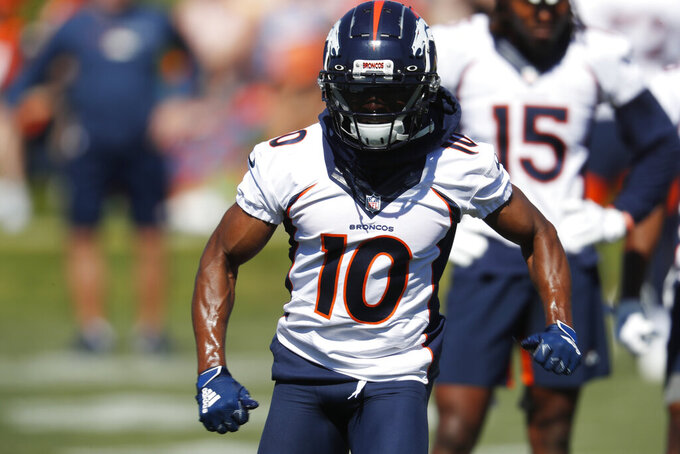 Denver Broncos wide receiver Emmanuel Sanders runs a route during drills at the team's NFL football training camp Friday, July 19, 2019, in Englewood, Colo. (AP Photo/David Zalubowski)