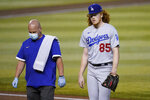 Los Angeles Dodgers starting pitcher Dustin May (85) is pulled from the baseball game during the second inning against the Arizona Diamondbacks, Thursday, Sept. 10, 2020, in Phoenix. May took a line drive off his foot in the first inning and was unable to continue. (AP Photo/Matt York)