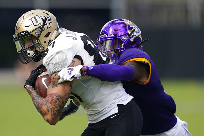 Central Florida wide receiver Jacob Harris (87) runs the ball while East Carolina defensive back Malik Fleming tackles during the first half of an NCAA college football game in Greenville, N.C., Saturday, Sept. 26, 2020. (AP Photo/Gerry Broome)