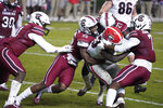 South Carolina's Gilber Edmond (55), Jammie Robinson (7) and Jaylan Foster (27) tackle Georgia running back Daijun Edwards (33) during the second half of an NCAA college football game Saturday, Nov. 28, 2020, in Columbia, S.C. Georgia won 45-16. (AP Photo/Sean Rayford)