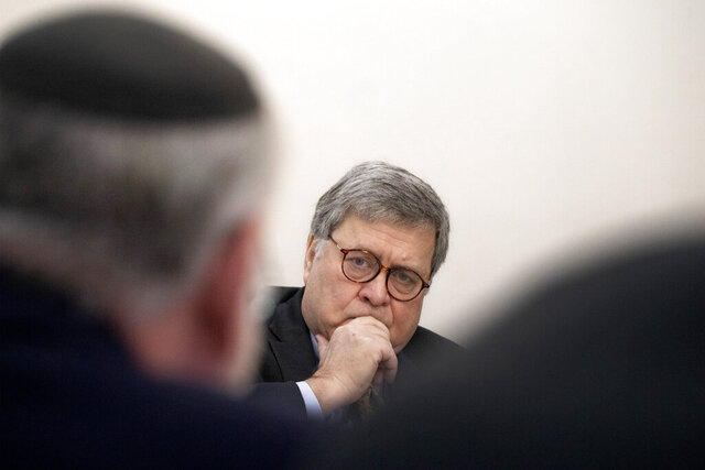 U.S. Attorney General William Barr listens during a meeting with Jewish leaders at the Boro Park Jewish Community Council, Tuesday, Jan. 28, 2020 in New York. Barr ordered federal prosecutors across the U.S. on Tuesday to step up their efforts to combat anti-Semitic hate crimes as he announced charges against a suspect who had slapped three Jewish women but was repeatedly released from jail under New York's bail reform laws. (AP Photo/Mark Lennihan)