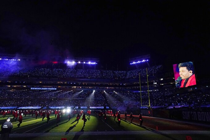 The Weeknd performs during the halftime show of the NFL Super Bowl 55 football game between the Kansas City Chiefs and Tampa Bay Buccaneers, Sunday, Feb. 7, 2021, in Tampa, Fla. (AP Photo/Ashley Landis)