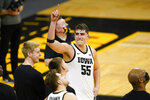 FILE - Iowa center Luka Garza (55) reacts during a video tribute following an NCAA college basketball game against Penn State in Iowa City, Iowa, in this Sunday, Feb. 21, 2021, file photo. Iowa's Luka Garza is The Associated Press men's basketball player of the year for the Atlantic Coast Conference and a member of The AP All-Big Ten first team announced Tuesday, March 9, 2021.  (AP Photo/Charlie Neibergall, File)
