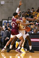 Missouri's Xavier Pinson, right, looks to pass as he is defended by Mississippi State's D.J. Stewart Jr., left, and Abdul Ado, back, during the first half of an NCAA college basketball game Saturday, Feb. 29, 2020, in Columbia, Mo. (AP Photo/L.G. Patterson)