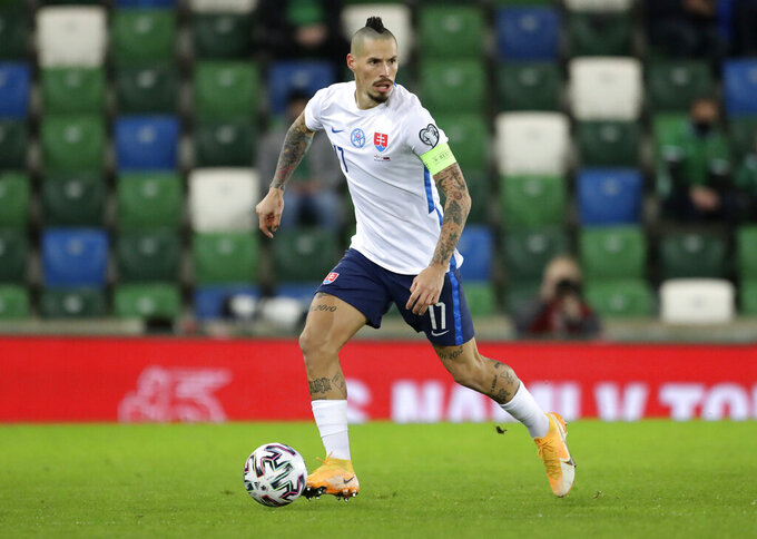 FILE - In this Thursday, Nov. 12, 2020 filer, Slovakia's Marek Hamsik looks to pass the ball during the Euro 2020 playoff semifinal soccer match between Northern Ireland and Slovakia at Windsor Park, Belfast, Northern Ireland. (AP Photo/Peter Morrison, File)