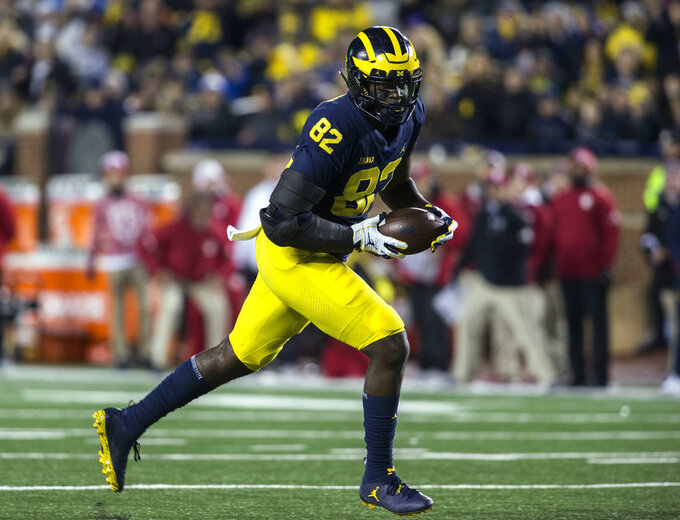 Michigan tight end Nick Eubanks (82) makes a 41-yard catch and rushes in for a touchdown in the second quarter of an NCAA college football game against Indiana in Ann Arbor, Mich., Saturday, Nov. 17, 2018. (AP Photo/Tony Ding)