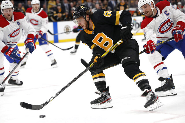 Boston Bruins' David Pastrnak goes around Montreal Canadiens defenseman Shea Weber during the second period of an NHL hockey game Sunday, Dec. 1, 2019, in Boston. (AP Photo/Winslow Townson)