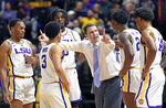 LSU head coach Will Wade has a word with his players, from left, Ja'vonte Smart (1), Tremont Waters (3), Naz Reid (0), Emmitt Williams (24) and Marlon Taylor (14) during a break in the first half of an NCAA college basketball game against Georgia, Wednesday, Jan. 23, 2019, in Baton Rouge, La. (AP Photo/Bill Feig)