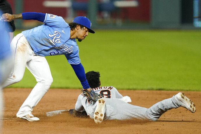 Kansas City Royals shortstop Adalberto Mondesi (27) tags out Detroit Tigers Niko Goodrum (28) during the eighth inning of a baseball game at Kauffman Stadium in Kansas City, Mo., Saturday, Sept. 26, 2020. Goodrum was caught stealing on the play. The Tigers defeated the Royals 4-3. (AP Photo/Orlin Wagner)