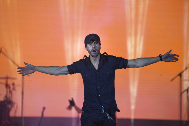FILE - In this May 27, 2018 file photo, Spanish singer Enrique Iglesias performs on stage in Tel Aviv, Israel. The pop star's contract with the city of McAllen, Texas— long hidden by what critics described as gaping holes in the state's open-records laws — became public this week after new legislation governing the public's right to know went into effect. (AP Photo/Ariel Schalit,File)
