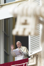 Pope Francis delivers his blessing as he recites the Angelus noon prayer from the window of his studio overlooking St.Peter's Square, at the Vatican, Sunday, Sept. 20, 2020. (AP Photo/Andrew Medichini)