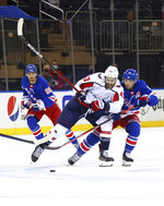 New York Rangers' Ryan Strome (16) holds back Washington Capitals' Tom Wilson (43) during the first period of an NHL hockey game Wednesday, May 5, 2021, in New York. (Bruce Bennett/Pool Photo via AP)
