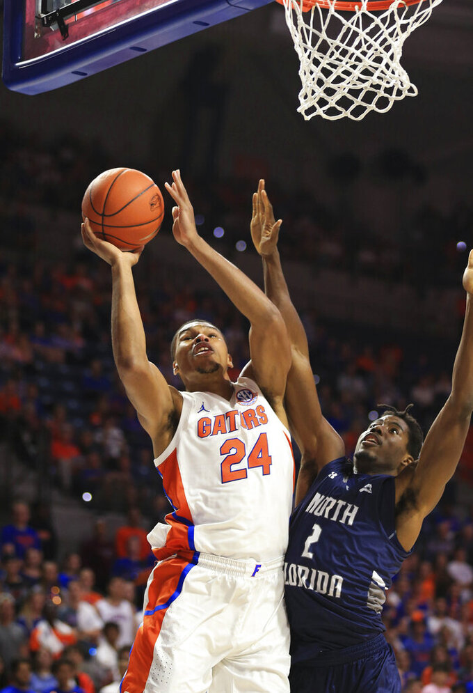 Florida forward Kerry Blackshear Jr. (24) makes a shot past North Florida forward Wajid Aminu (2) during the first half of an NCAA college basketball game Tuesday, Nov. 5, 2019, in Gainesville, Fla. (AP Photo/Matt Stamey)