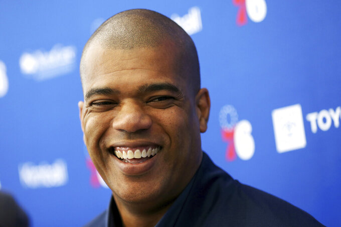 FILE- In this June 13, 2019, file photo, Philadelphia 76ers NBA basketball team executive Marc Eversley smiles while talking to reporters during a pre-draft workout at the Sixers Training Complex in Camden, N.J. Eversley, now GM of the Chicago Bulls, is one of 12 people of color serving as general managers or heading basketball operations in the NBA according to a league diversity study by The Institute for Ethics and Diversity in Sport (TIDES) at Central Florida.  (Tim Tai/The Philadelphia Inquirer via AP)
