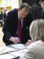 Rep. Andy Barr, R-Ky., signs in to cast his vote in Lexington, Ky., Tuesday, Nov. 6, 2018. (AP Photo/Timothy D. Easley)