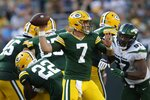 Green Bay Packers' Kurt Benkert throws during the second half of a preseason NFL football game against the New York Jets Saturday, Aug. 21, 2021, in Green Bay, Wis. (AP Photo/Matt Ludtke)