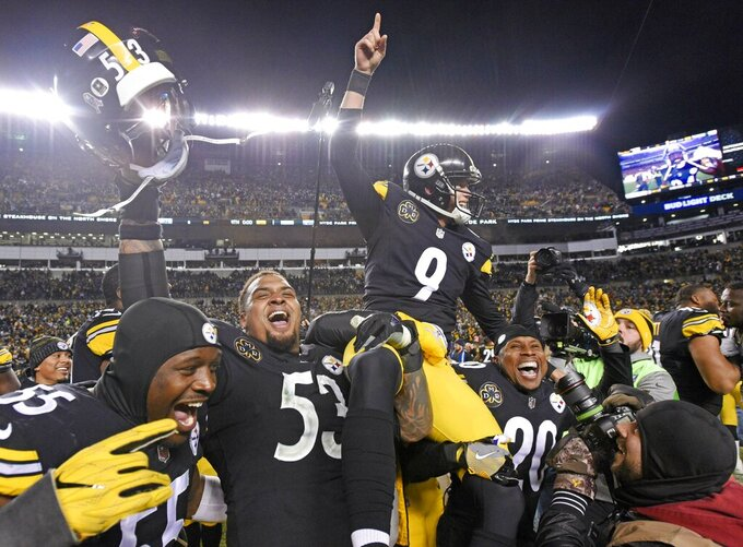 FILE - In this Nov. 26, 2017, file photo, Pittsburgh Steelers kicker Chris Boswell (9) is carried off the field after kicking the game-winning field goal against the Green Bay Packers in Pittsburgh. The Steelers kicker knows his underwhelming 2018 season directly contributed to the Steelers missing the playoffs. Yet rather than reinvent his offseason routine, he doubled down confident, he could bounce back. (AP Photo/Don Wright, File)