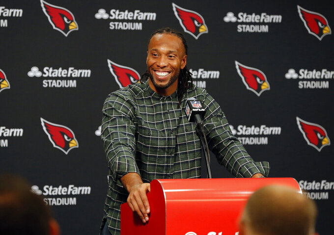 "FILE - In this Dec. 23, 2018, file photo, Arizona Cardinals wide receiver Larry Fitzgerald speaks after an NFL football game against the Los Angeles Rams, in Glendale, Ariz. Star receiver Larry Fitzgerald is returning to the Arizona Cardinals for a 16th NFL season. The Cardinals announced Wednesday, Jan. 23, 2019, that they signed the 35-year-old Fitzgerald to a one-year contract. Team president Michael Bidwell says, ""No player has meant more to this franchise or this community than Larry Fitzgerald."" (AP Photo/Rick Scuteri, File)"