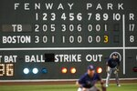 Tampa Bay Rays' Yoshitomo Tsutsugo, right, plays in left field during the ninth inning of a baseball game against the Boston Red Sox, Thursday, Aug. 13, 2020, in Boston. (AP Photo/Michael Dwyer)