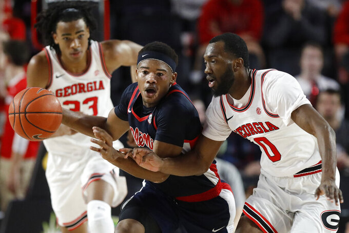 Mississippi guard Devontae Shuler (2) moves the ball past Georgia guard William Jackson II (0) during an NCAA college basketball game in Athens, Ga., on Saturday, Feb. 9, 2019. (Joshua L. Jones/Athens Banner-Herald via AP)