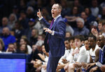 Xavier head coach Travis Steele directs his team against St. John's during the first half of an NCAA college basketball game, Sunday, Jan. 5, 2020, in Cincinnati. (AP Photo/Gary Landers)