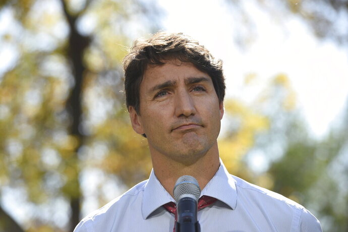 Canada's Prime Minister Justin Trudeau addresses the media in Winnipeg, Manitoba, Thursday, Sept. 19, 2019. Trudeau's campaign was hit Wednesday by the publication of a yearbook photo showing him in brownface makeup at a 2001 costume party. The prime minister apologized and said