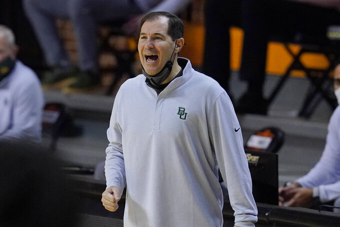 Baylor head coach Scott Drew shouts in the first half of an NCAA college basketball game Oklahoma State, Saturday, Jan. 23, 2021, in Stillwater, Okla. (AP Photo/Sue Ogrocki)