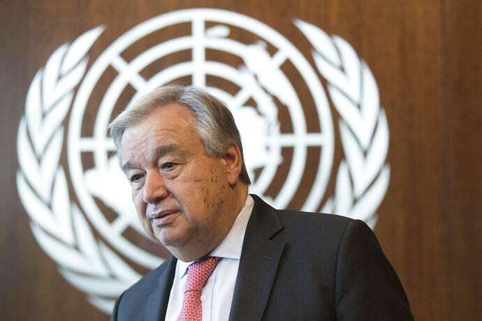 FILE - In this May 7, 2019, file photo, United Nations Secretary-General Antonio Guterres is photographed during an interview at United Nations headquarters. Guterres has strongly rejected claims by five human rights group that he hasn't condemned the Chinese government's detention of more than a million Muslims in the Xinjiang region, saying he has spoken out forcefully. (AP Photo/Mary Altaffer, File)