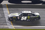 Ty Gibbs (54) crosses the finish line to win the NASCAR Xfinity Series road course auto race at Daytona International Speedway, Saturday, Feb. 20, 2021, in Daytona Beach, Fla. (AP Photo/John Raoux)