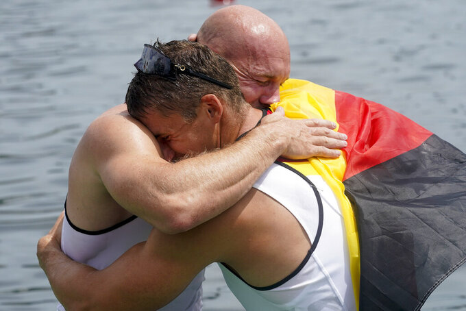 Ronald Rauhe and Tom Liebscher, of Germany, react to their gold medal finish in the men's kayak four 500m final at the 2020 Summer Olympics, Saturday, Aug. 7, 2021, in Tokyo, Japan. (AP Photo/Darron Cummings)