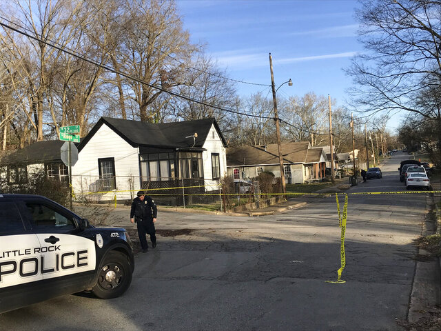 Police work at the scene of a shooting at a residence in Little Rock, Ark., on Saturday, Jan. 25, 2020. Police in Arkansas say two women have been killed and a 2-year-old boy injured in a shooting at their home. (Thomas Metthe/The Arkansas Democrat-Gazette via AP)