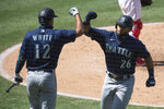 Seattle Mariners' Jose Marmolejos, right, and Evan White celebrate Marmolejos' solo home run during the sixth inning of a baseball game in Anaheim, Calif., Monday, Aug. 31, 2020. (AP Photo/Kyusung Gong)