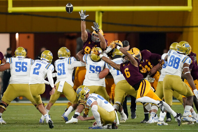 UCLA's Nicholas Barr-Mira (2) kicks a field goal against Arizona State during the first half of an NCAA college football game Saturday, Dec. 5, 2020, in Tempe, Ariz. (AP Photo/Matt York)