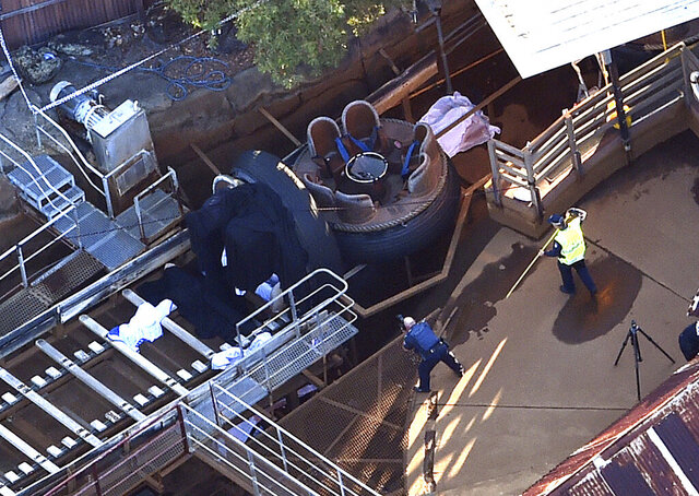 Emergency service personnel investigate at an accident scene at an amusement theme park on the Gold Coast, Australia, Oct. 25, 2016. The company that owns the Australian theme park where four people died on a river rapids ride was fined 3.6 million Australian dollars ($2.5 million) on Monday, Sept. 28, 2020, for safety breaches that led to the 2016 tragedy. (Dan Peled/AAP Image via AP)