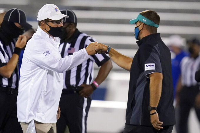 Kansas head coach Les Miles, left, greets Coastal Carolina head coach Jamey Chadwell before an NCAA college football game in Lawrence, Kan., Saturday, Sept. 12, 2020. (AP Photo/Orlin Wagner)